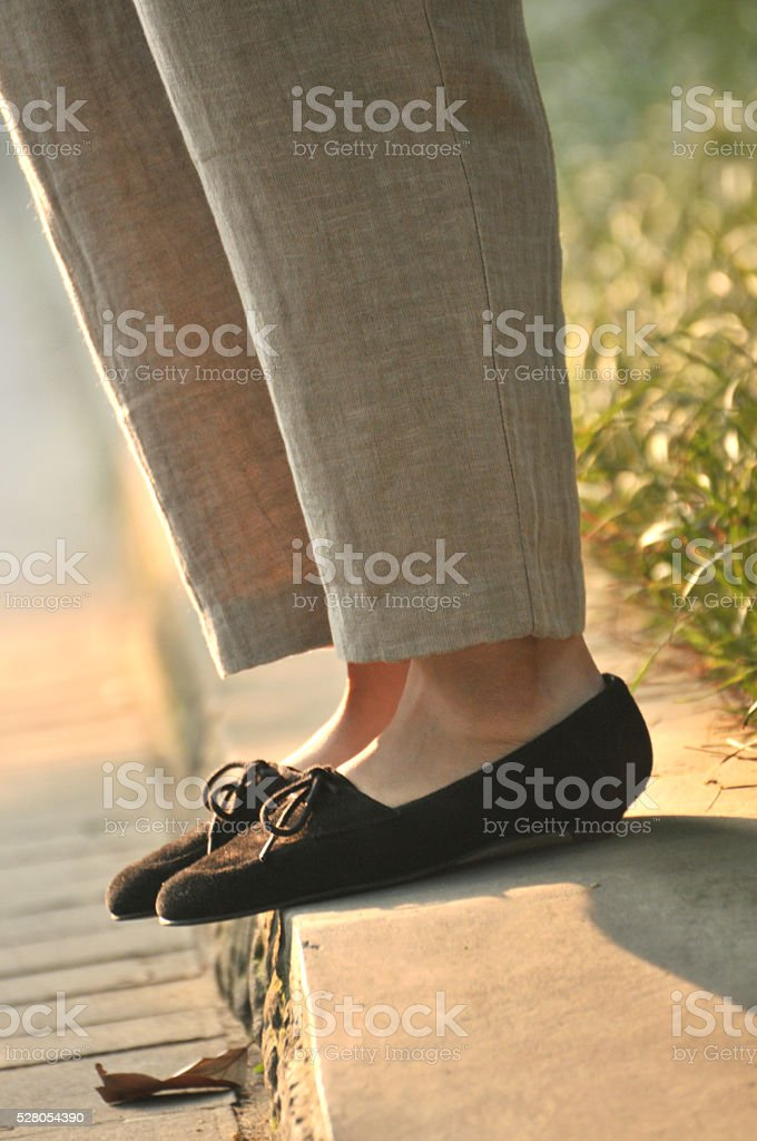 Chinese woman in casual linen trousers and shoes stock photo
