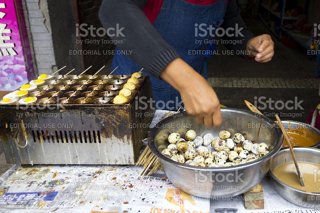 Chinese woman preparing quail egg omelets royalty-free stock photo