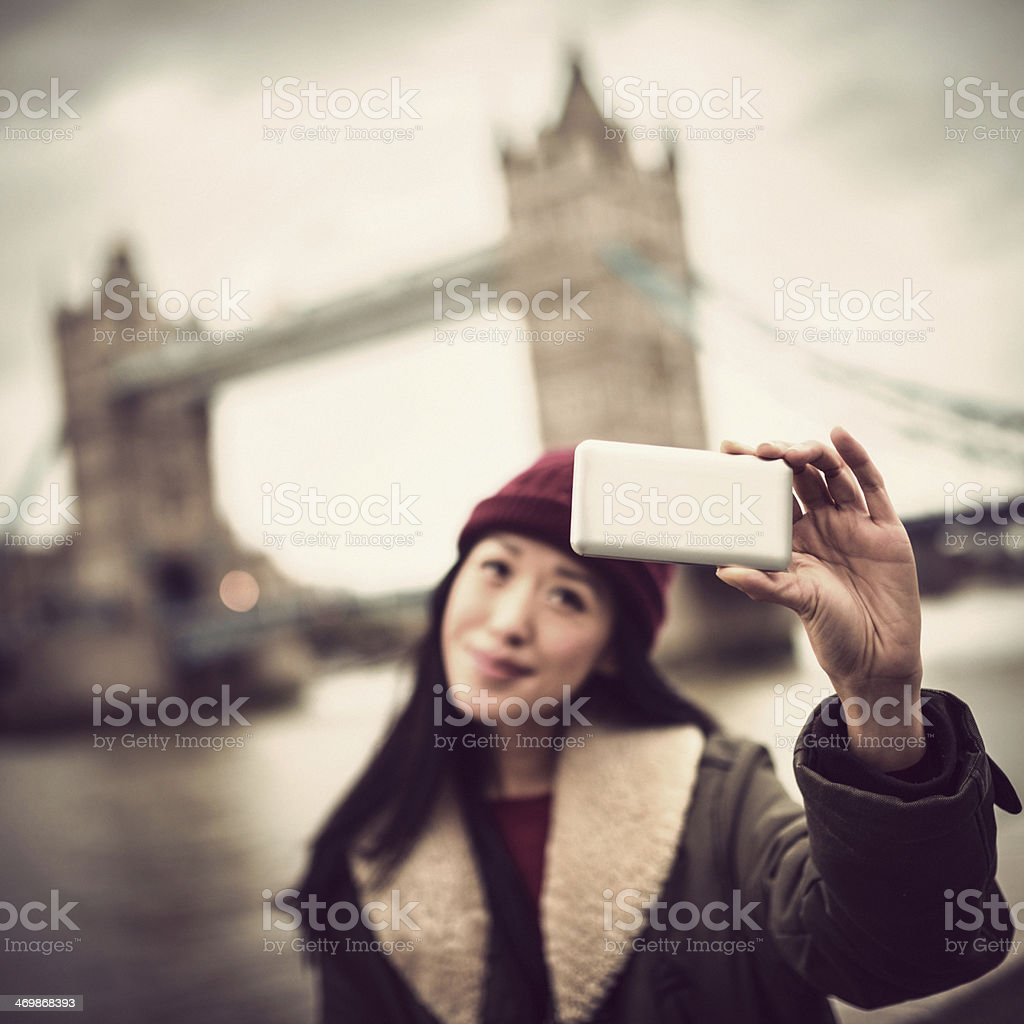 chinese woman self photographing in London stock photo