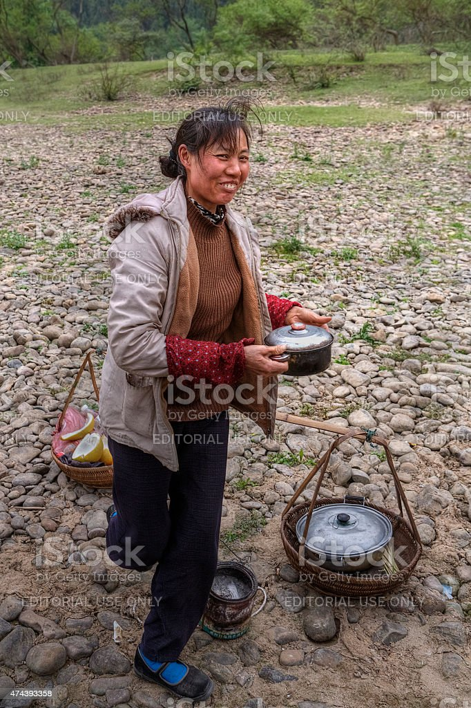 Chinese woman sells hot food in the countryside, Guangxi, China. stock photo