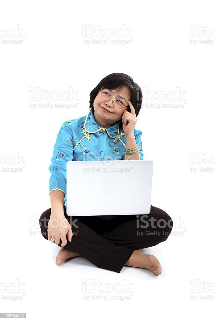 Chinese Woman with laptop, thinking stock photo