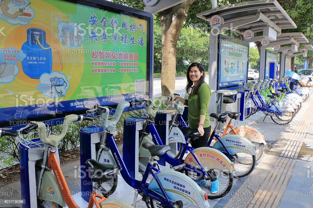 Chinese women are using the bike at station rental bike stock photo