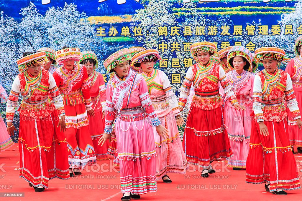 Chinese women dressed with traditional clothing dancing and singing stock photo