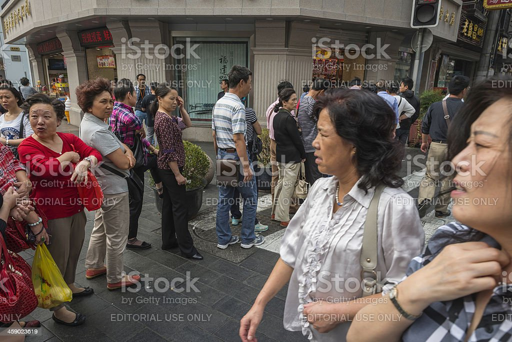 Chinese women queuing on Nanjing Road shops Shanghai royalty-free stock photo