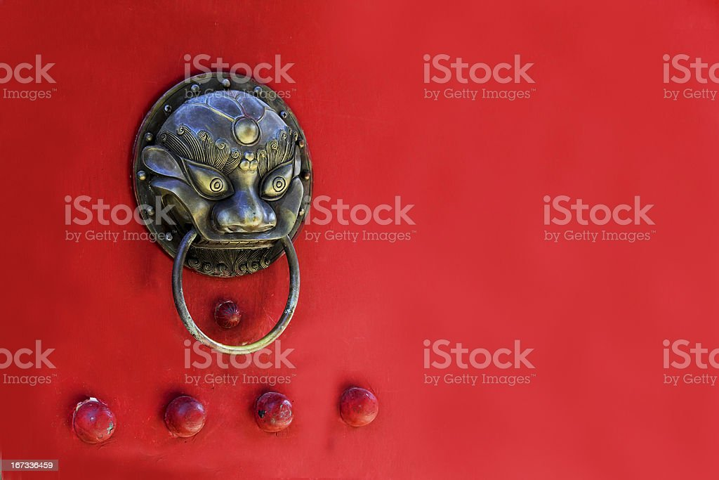 Chinese wooden door and animal knocker stock photo