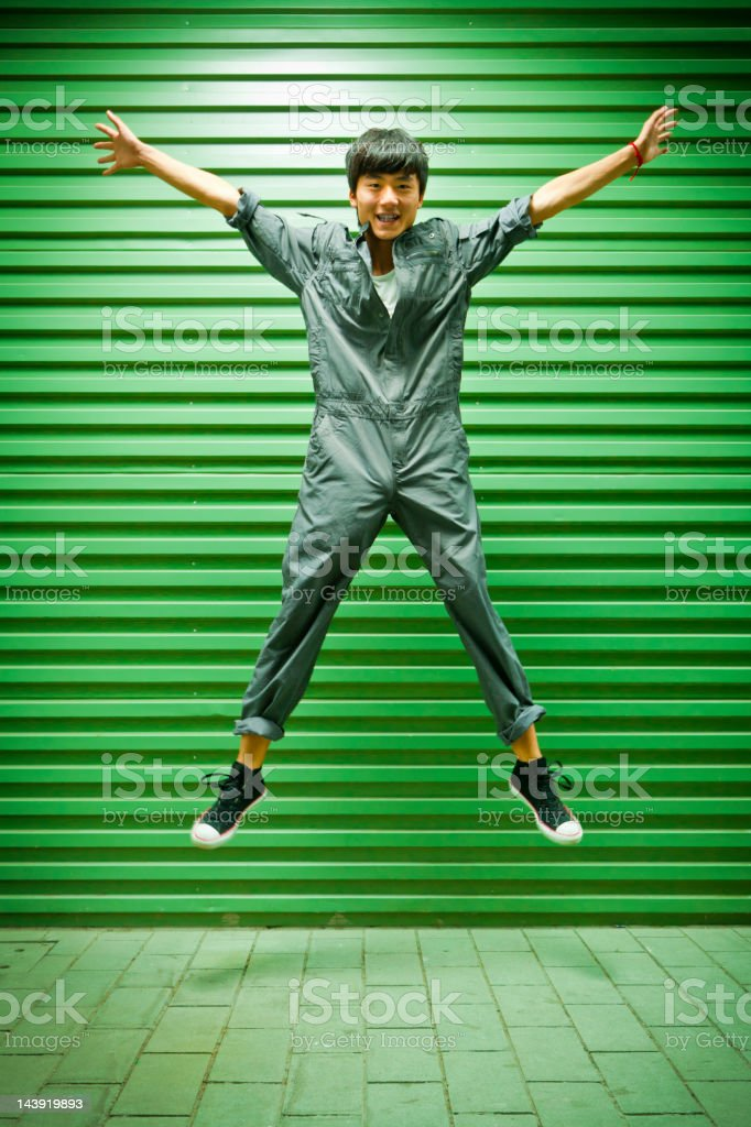 Chinese worker jumping in industrial area royalty-free stock photo