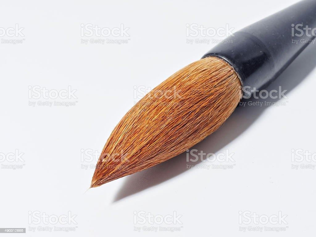 Chinese writing brush on white background stock photo