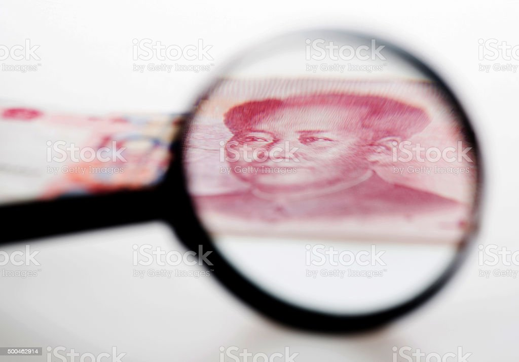 Chinese yuan and magnify stock photo
