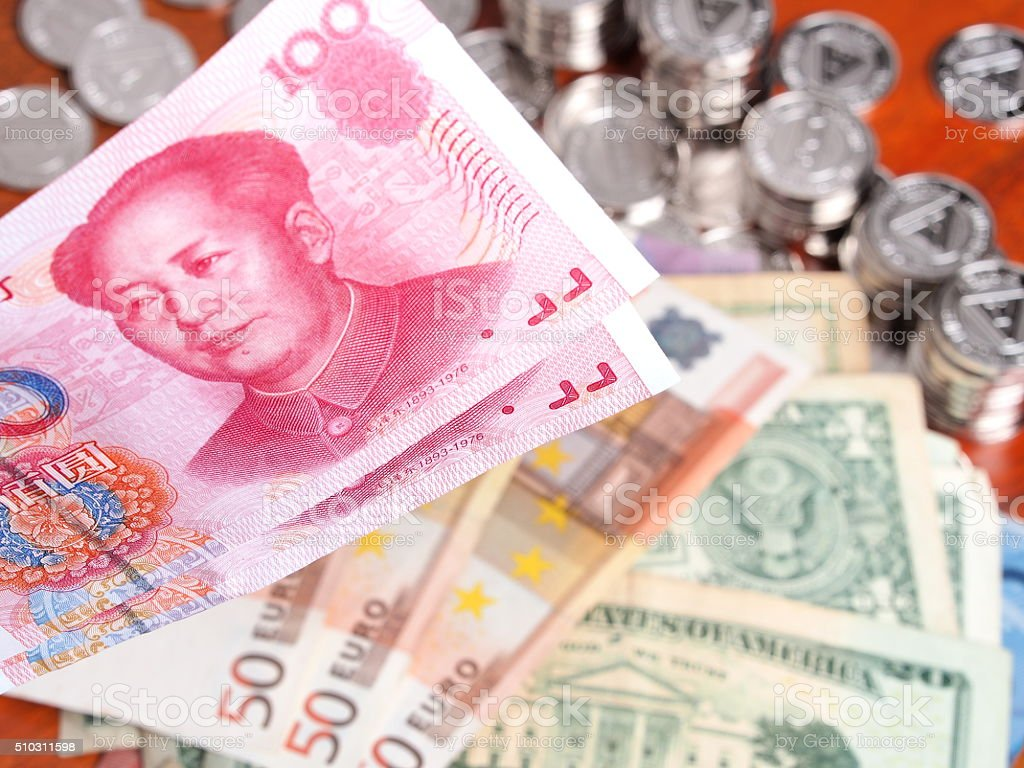 Chinese Yuan note in front of  Euro and US Dollar stock photo