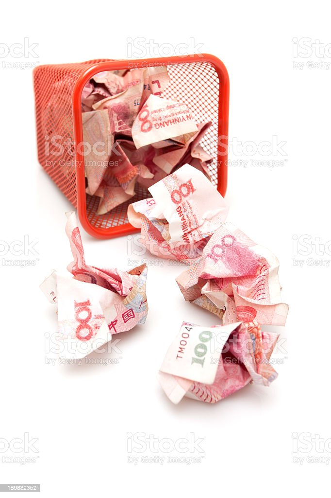 Chinese Yuan Note in wastepaper basket isolated  on white background royalty-free stock photo