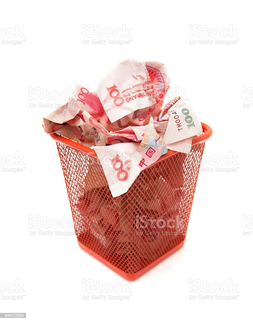 Chinese Yuan Note in wastepaper basket isolated stock photo