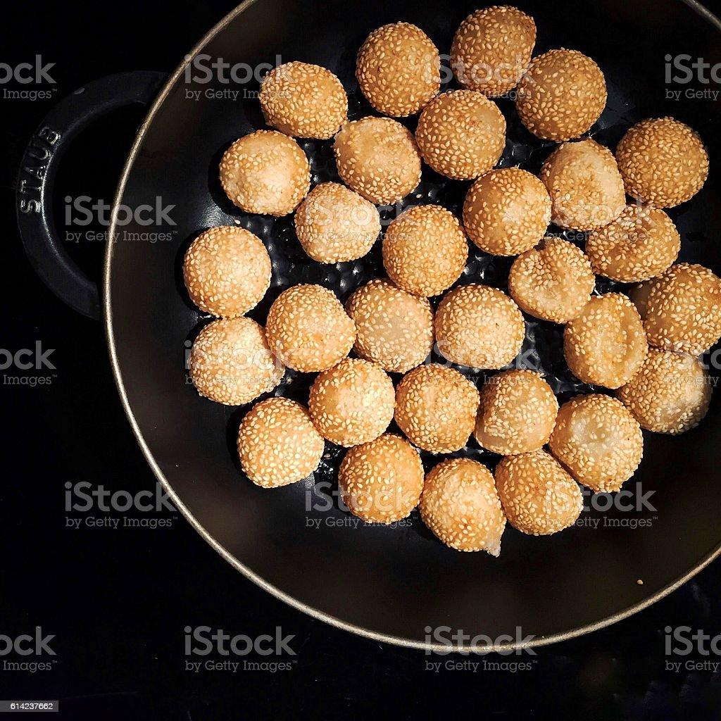 Chinese/Hong Kong dim sum: Red bean sesame balls in pan stock photo