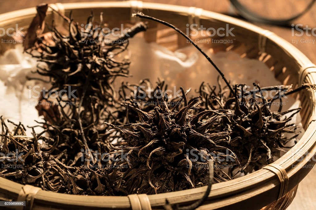 Chinesse Tea Da Hong Pao or Conifer Cone. stock photo