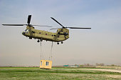 Chinook Carrying a container