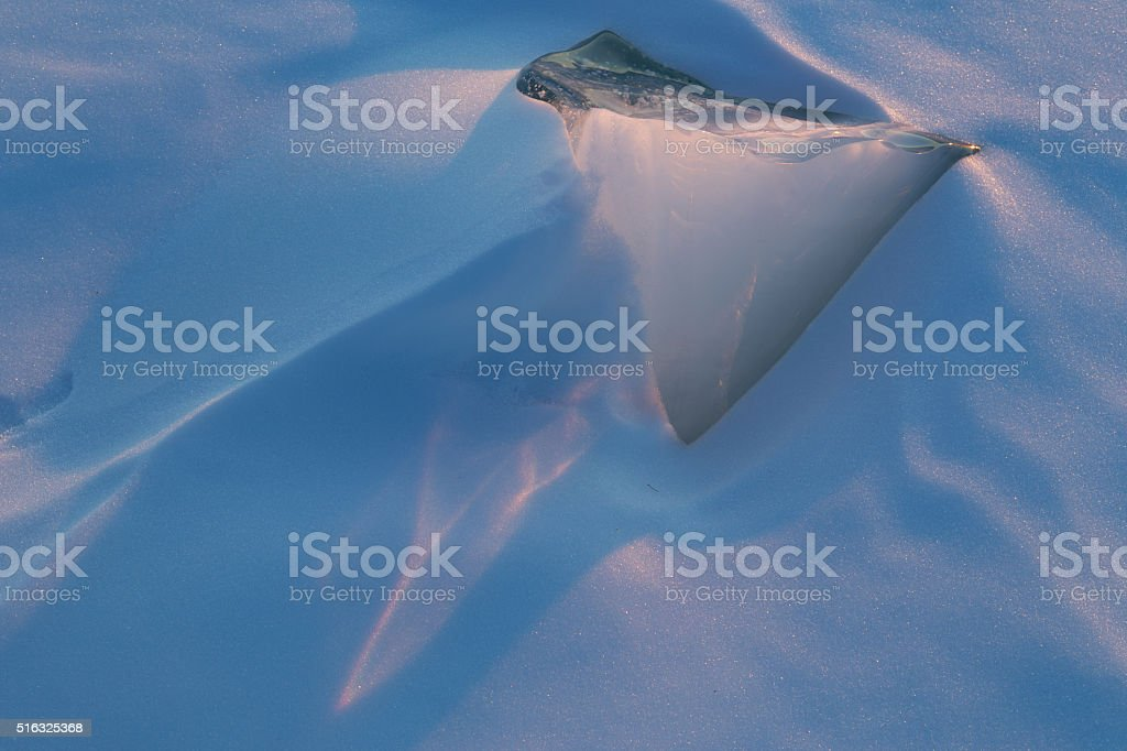Chip ice in the snow on the river. stock photo