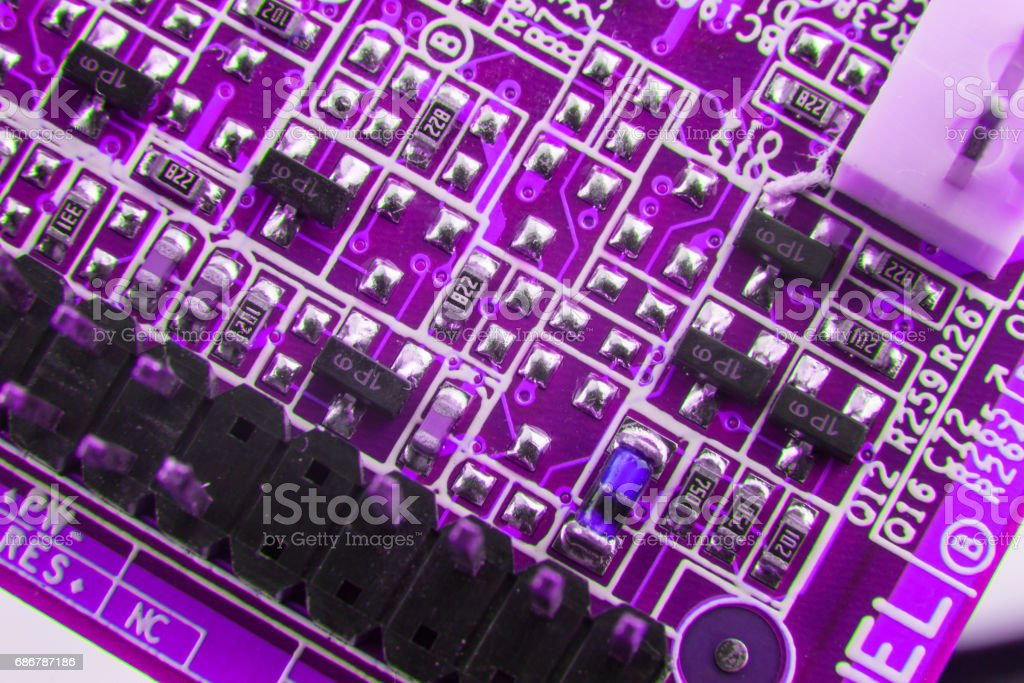 Chip on motherboard mainboard with controllers, ports and wires, close-up macro toned stock photo