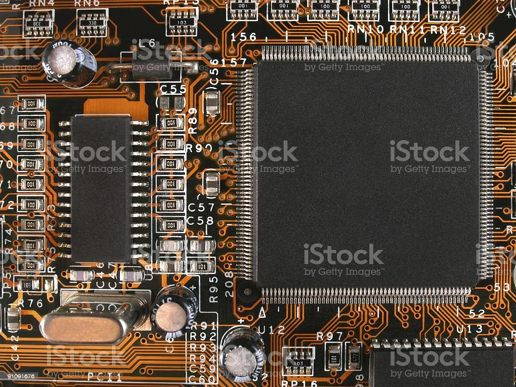 Chip on the orange motherboard royalty-free stock photo