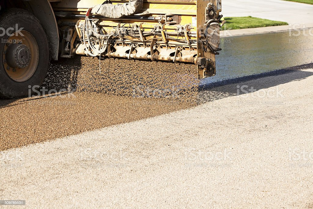 Chip Sealing Asphalt Pavement Street with Crushed Rock stock photo