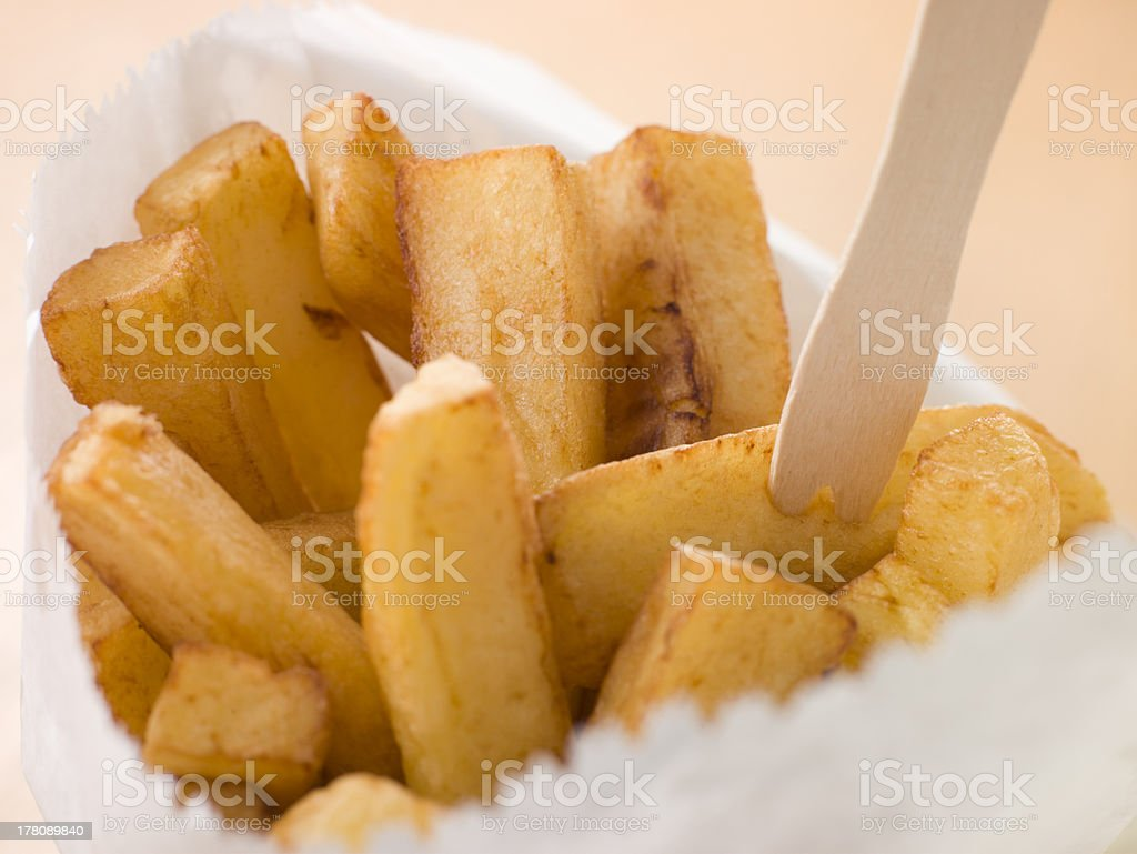 Chip Shop Chips in a Bag with Wooden Fork stock photo