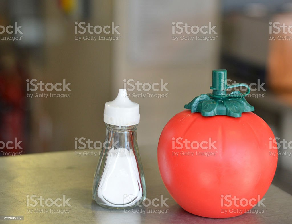 Chip shop salt and tomato ketchup stock photo