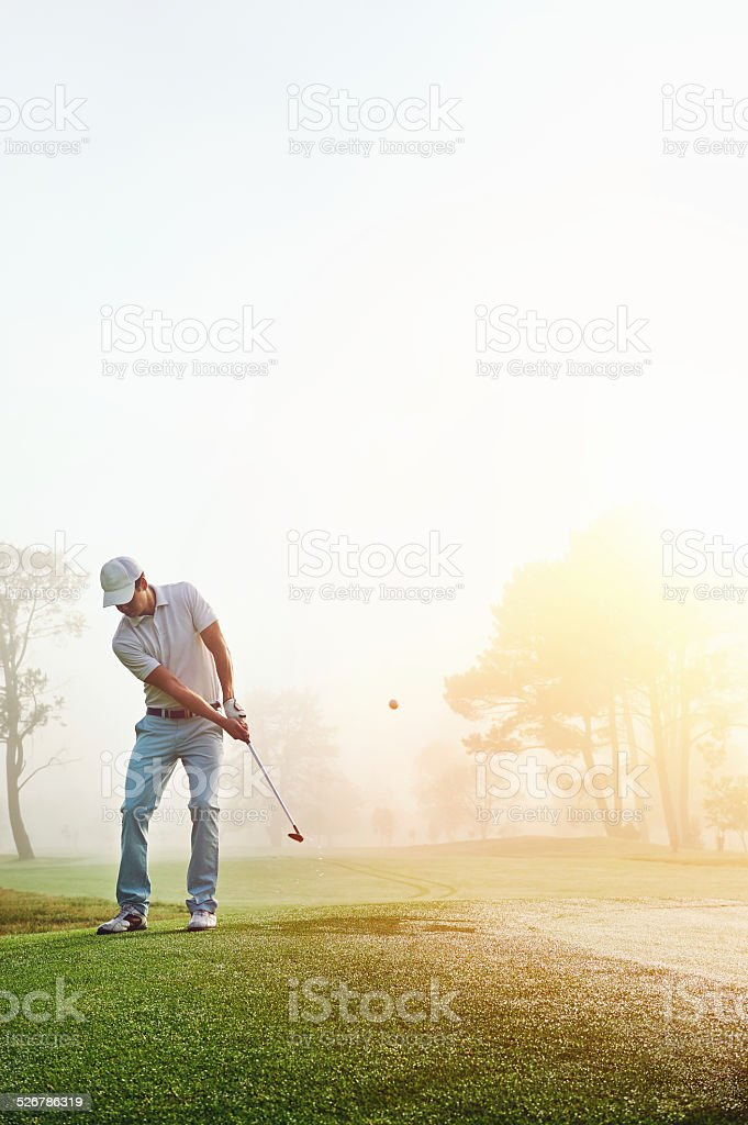 chip shot golf stock photo