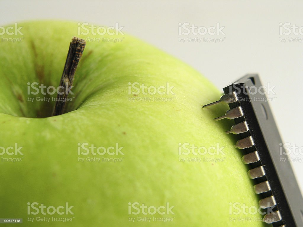 Chip-attack on green apple! stock photo