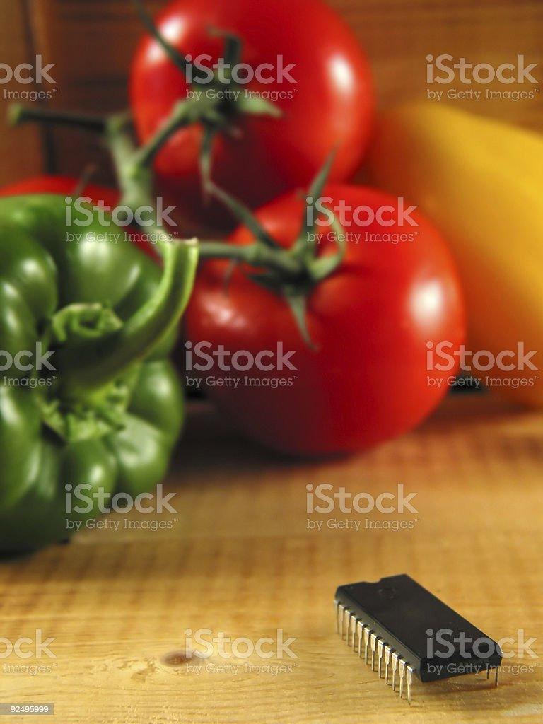 Chip-attack on veggies! stock photo
