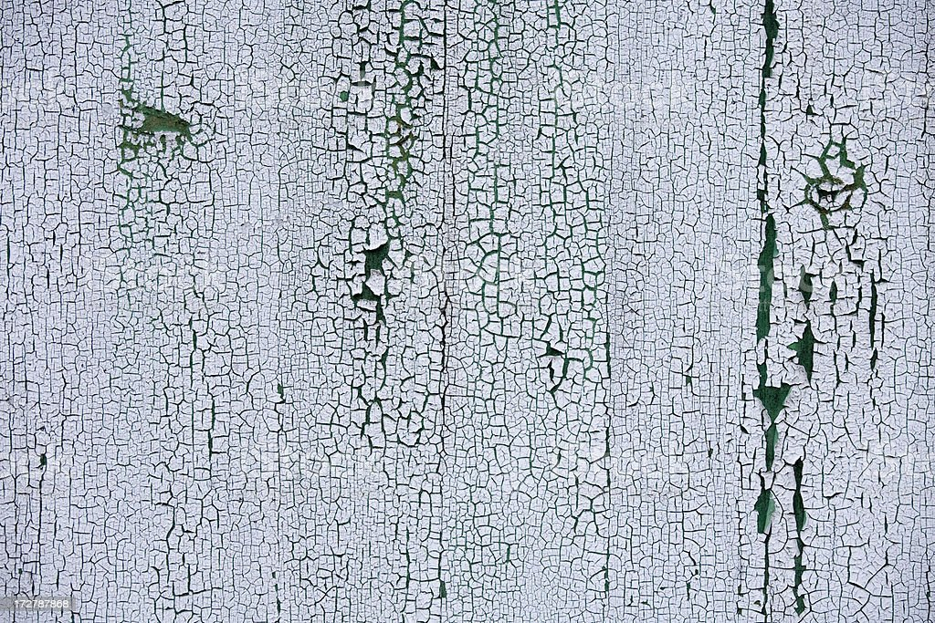 Chipped and peeling white paint on green wall royalty-free stock photo