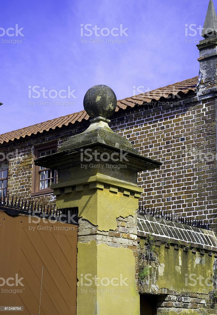 Chipped Ornate Fence Post in Charleston, SC royalty-free stock photo