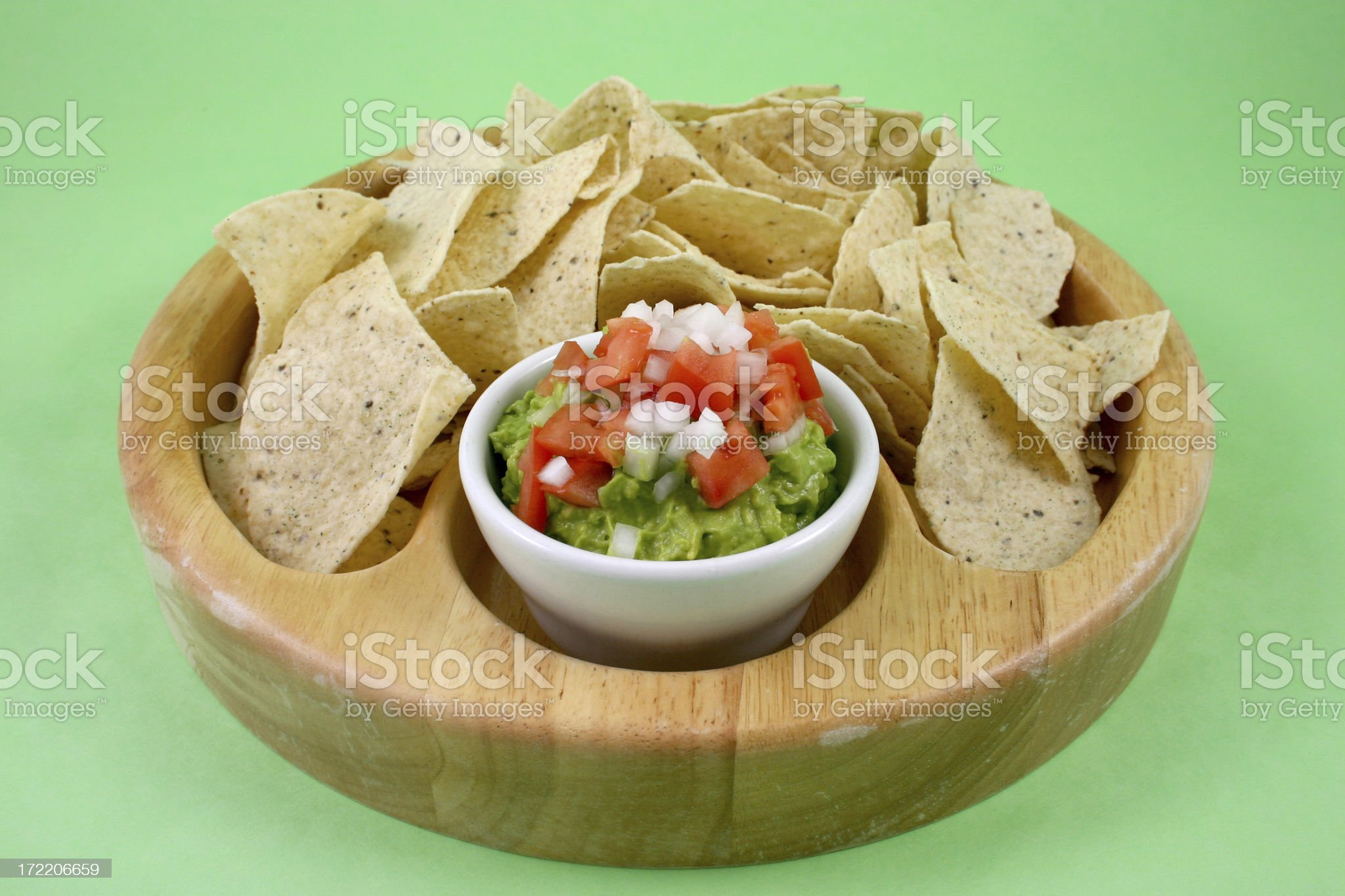 chips and guacamole on green. royalty-free stock photo
