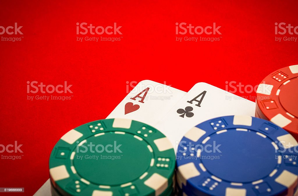 Chips and pair of aces stock photo