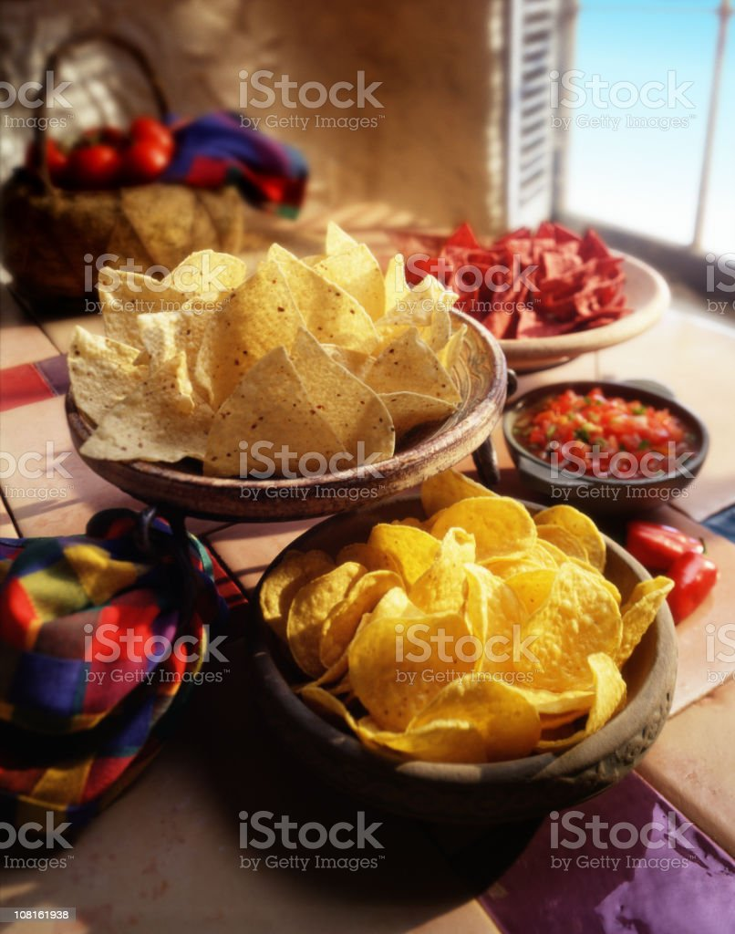 Chips and salsa in a festive spanish setting. stock photo