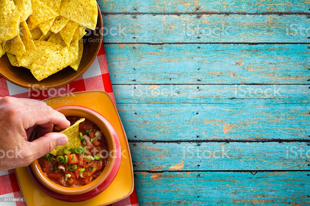 Chips and Salsa on Rustic Blue Background stock photo