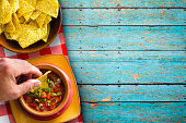 Chips and Salsa on Rustic Blue Background
