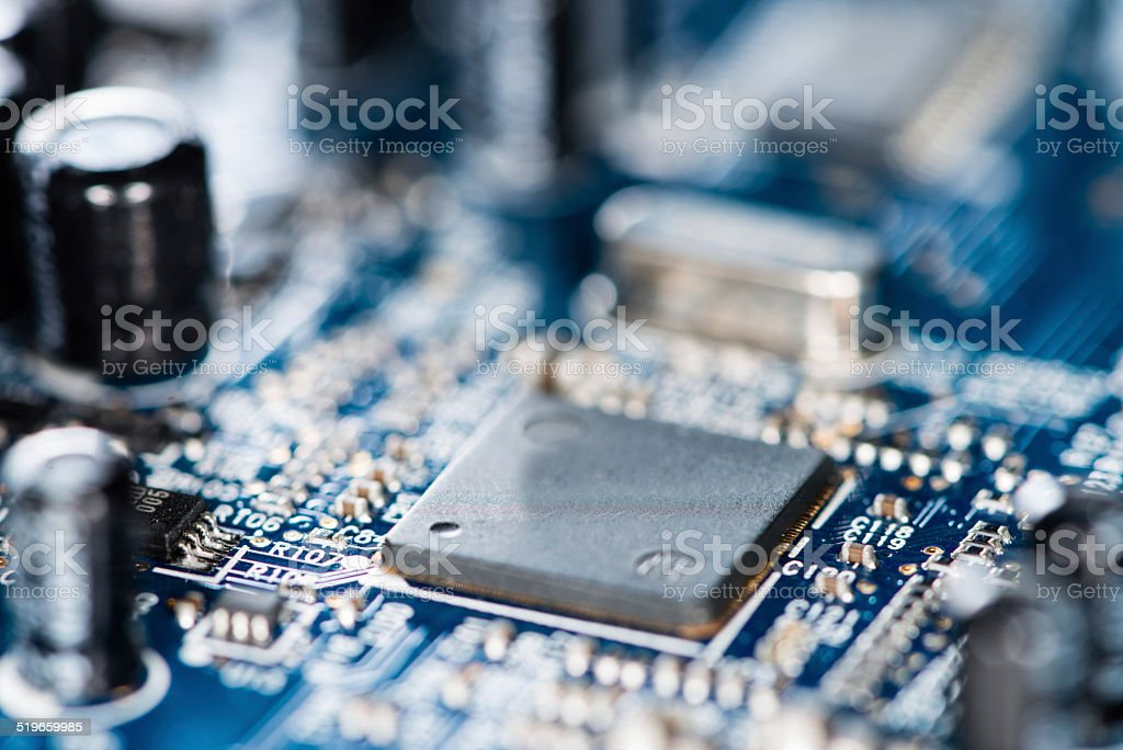 Chips on a blue PCB stock photo