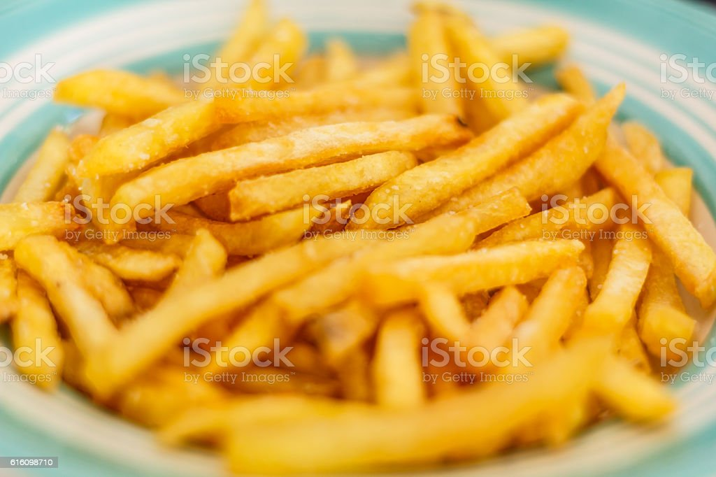 Chips, potatoes frying in the pan in olive oil stock photo