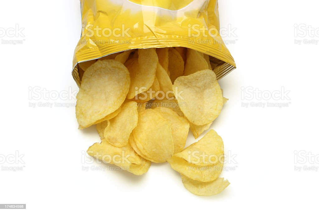 Chips spilling out of an open bag stock photo