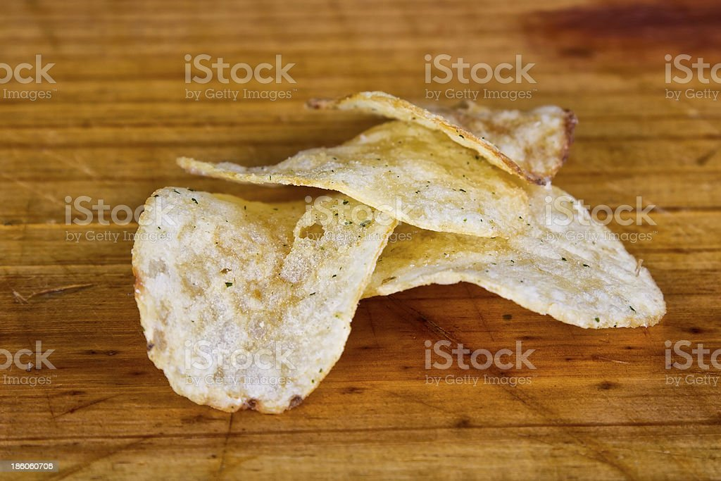 Chips stack on wood surface royalty-free stock photo