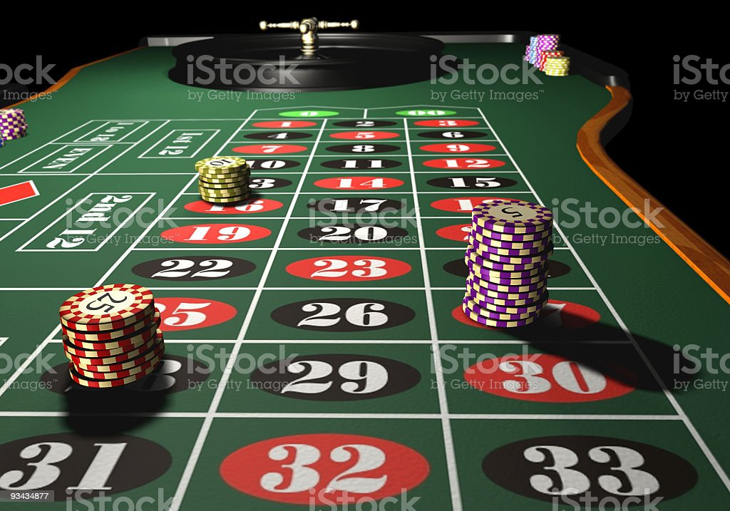 Chips stacked on a roulette betting board stock photo