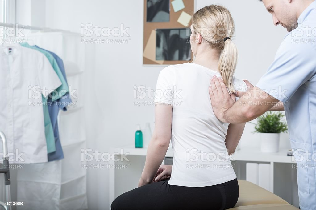 Chiropractic doing spinal mobilisation stock photo