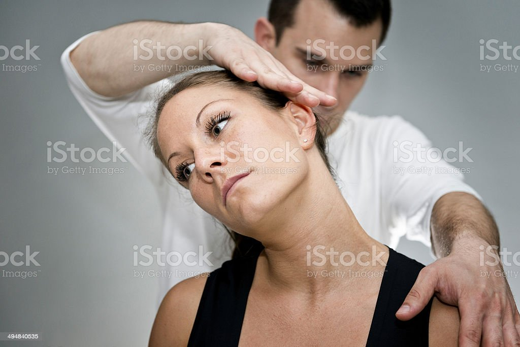 Chiropractic neck adjustment stock photo
