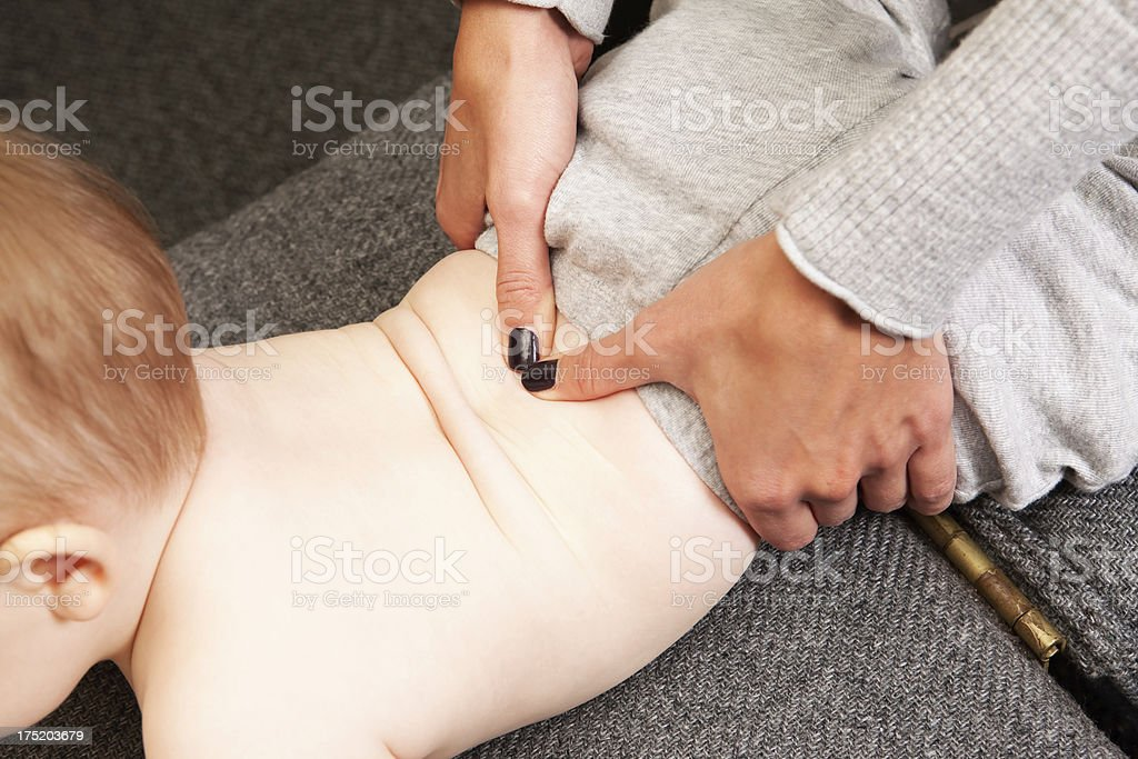 Chiropractor Adjusting Infant Spine royalty-free stock photo