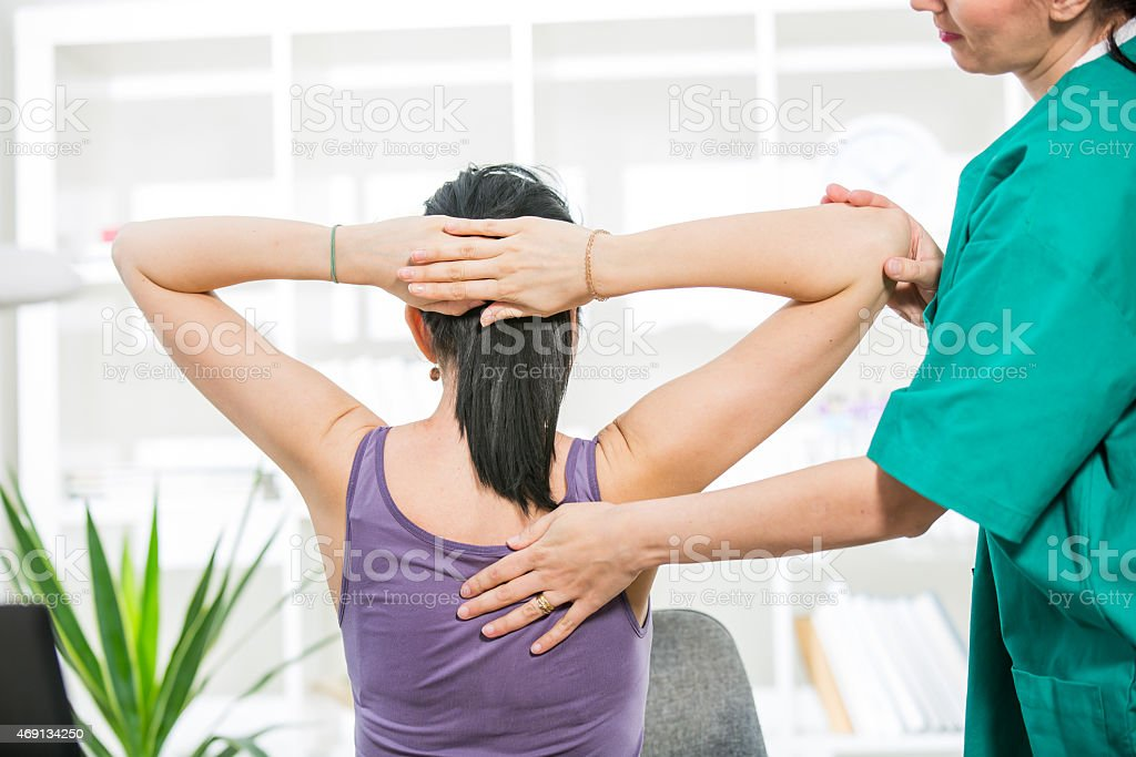 Chiropractor massage patient spine and back stock photo