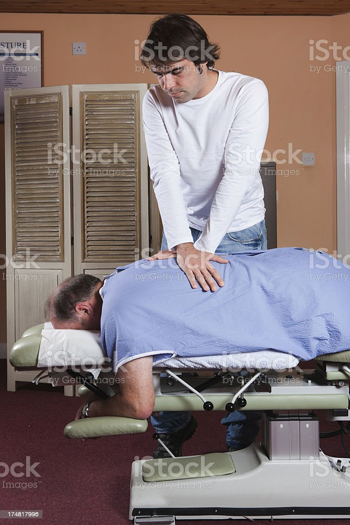 Chiropractor / orthopedist at work royalty-free stock photo