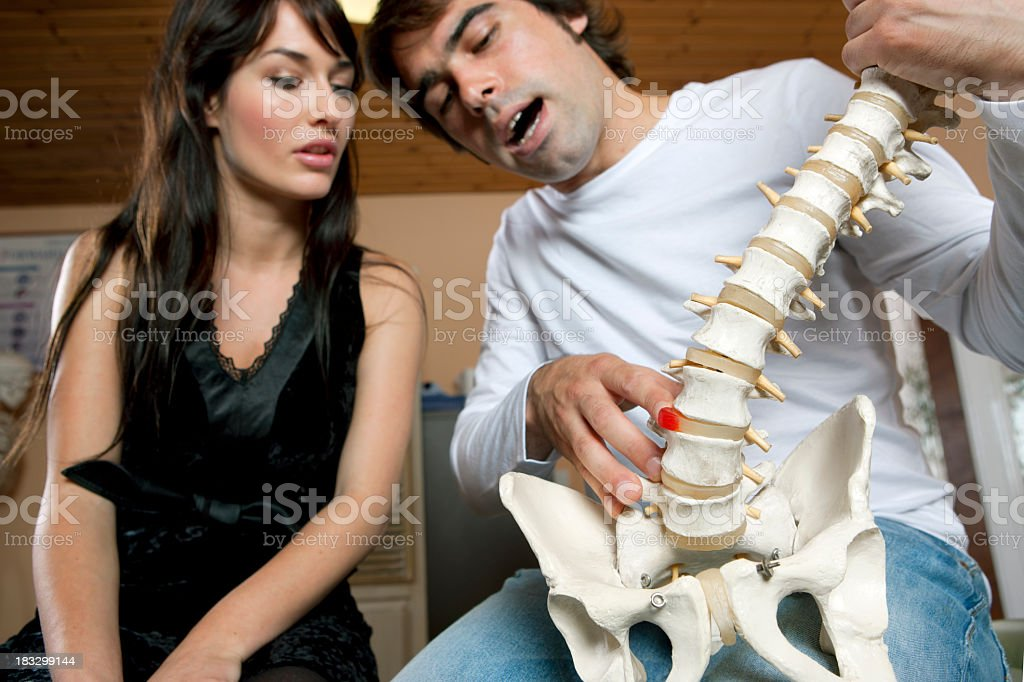 Chiropractor / orthopedist with a patient stock photo