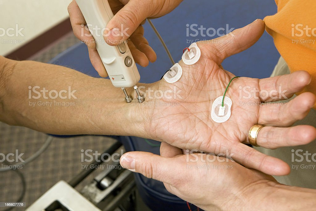 Chiropractor Performing a Median NCV (Nerve Conduction Velocity) Test stock photo