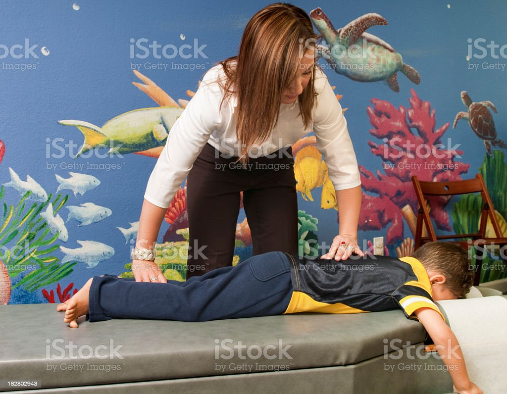 Chiropractor Treating a Child royalty-free stock photo