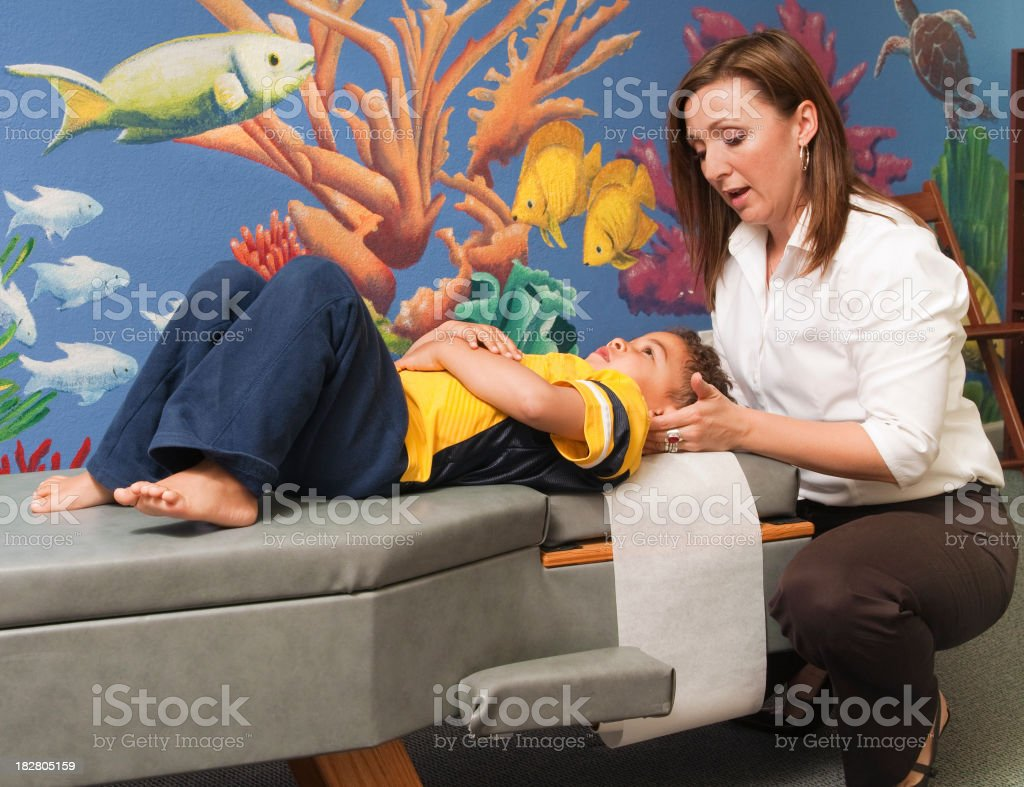Chiropractor Treating a Child stock photo