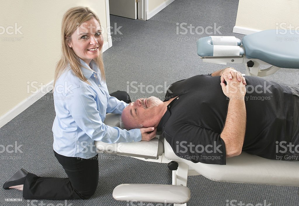 Chiropractor Treating a Man's Neck royalty-free stock photo