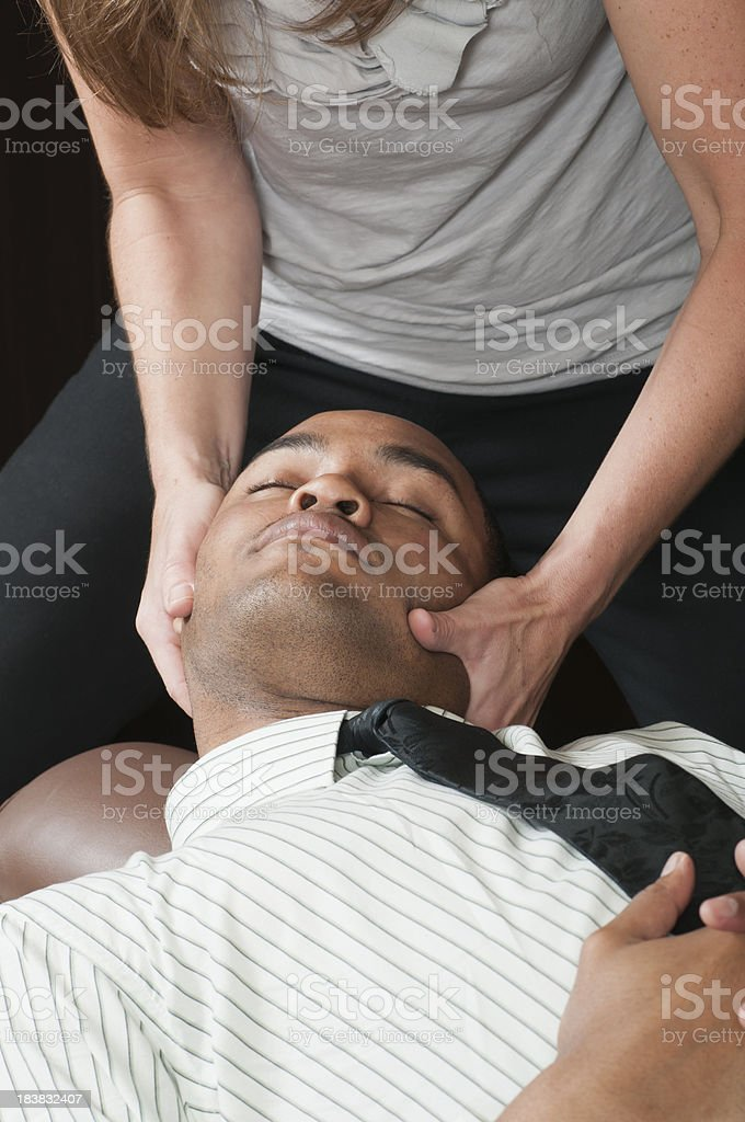 Chiropractor Treating Businessman's Neck royalty-free stock photo